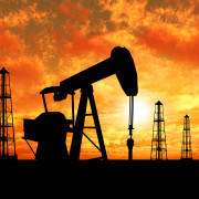 Silhouette oil rigs and pumps